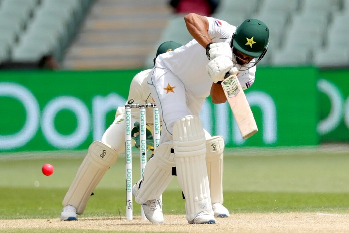Pakistan's Shaan Masood plays a shot during their cricket test match against Australia in Adelaide, Monday, Dec. 2, 2019. (AP Photo/James Elsby)
