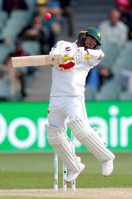 Pakistan's Mohammad Rizwan plays a shot during their cricket test match against Australia in Adelaide, Monday, Dec. 2, 2019. (AP Photo/James Elsby)