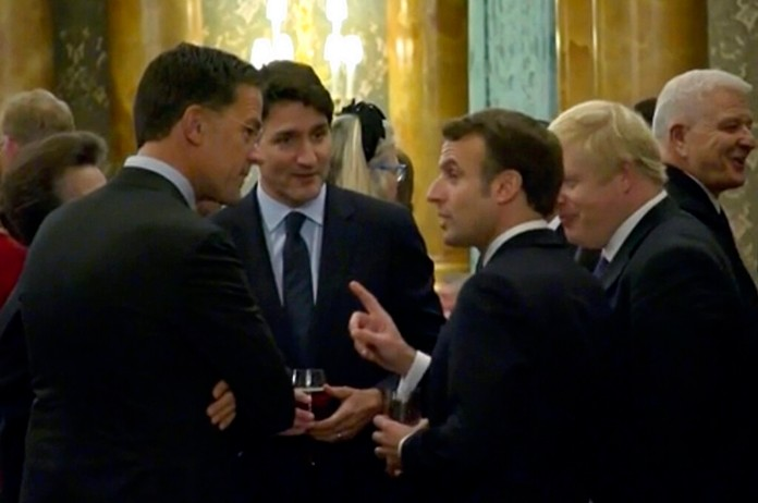 In this grab taken from video on Tuesday, Dec. 3, 2019, France's President Emmanuel Macro, centre right, gestures as he speaks during a NATO reception. (Host Broadcaster via AP)