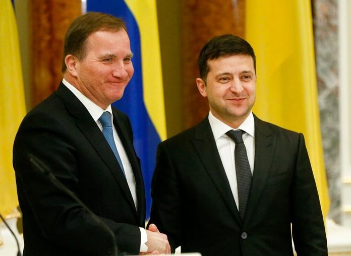 Ukrainian President Volodymyr Zelenskiy, right, welcomes Sweden's Prime Minister Stefan Lofven during their meeting in Kyiv, Ukraine, Wednesday, Dec. 4, 2019. ( AP Photo/Efrem Lukatsky)