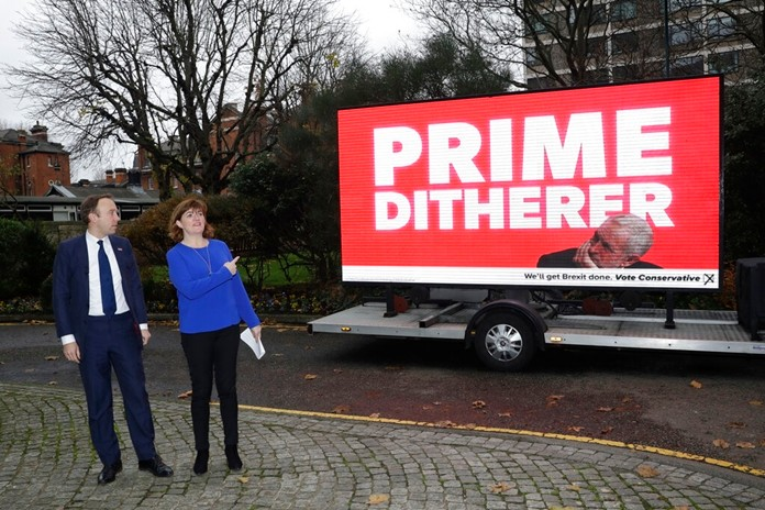 In this Monday, Nov. 25, 2019 file photo, British Conservative party Health Secretary Matt Hancock and his party colleague the Secretary of State for Digital, Culture, Media & Sport Nicky Morgan, in London as they launch their party's digital election campaign poster highlighting what they see as the opposition Labour Party leader Jeremy Corbyn's indecision. (AP Photo/Matt Dunham, File)