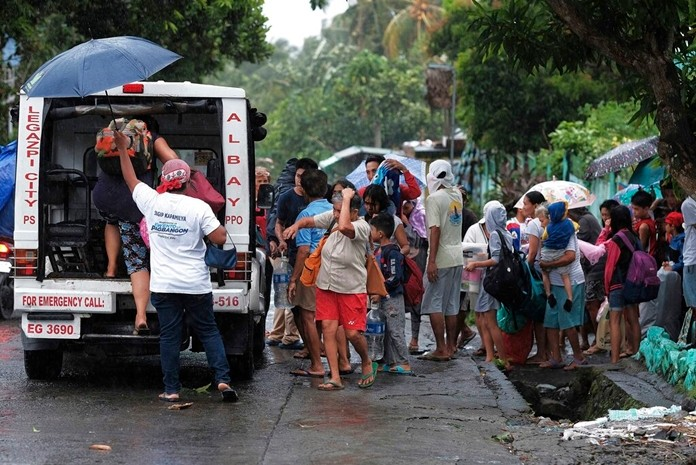 Residents evacuate their area in preparation for the coming of Typhoon Kammuri in Legazpi, Albay province, southeast of Manila, Philippines on Monday Dec. 2, 2109. (AP Photo)