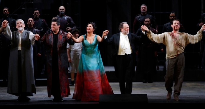 "From left, Alfonso Antoniozzi, Luca Salsi, Anna Netrebko, conductor Riccardo Chailly and Francesco Meli acknowledge the applause of the audience at the end of La Scala opera house's gala season opener, Giacomo Puccini's opera ""Tosca"" at the Milan La Scala theater, Italy, Saturday, Dec. 7, 2019. (AP Photo/Luca Bruno)"