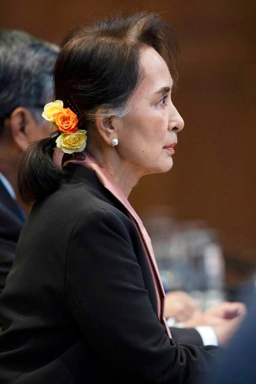 Myanmar's leader Aung San Suu Kyi sits in the court room of the International Court of Justice for the first day of three days of hearings in The Hague, Netherlands, Tuesday, Dec. 10, 2019. (AP Photo/Peter Dejong)