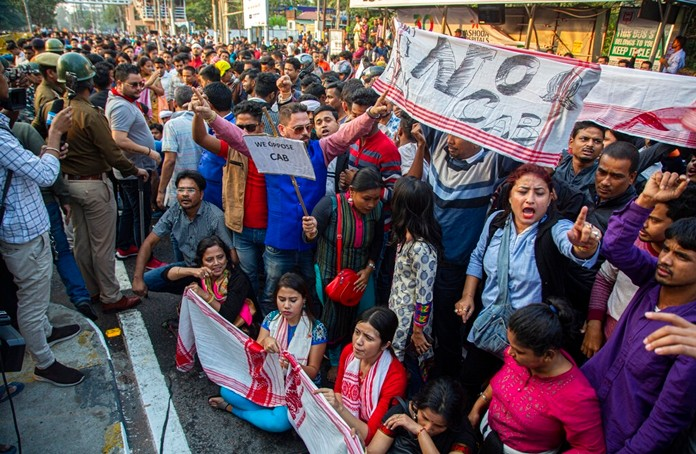 Protesters shout slogans against the Citizenship Amendment Bill (CAB) in Gauhati, India, Wednesday, Dec. 11, 2019. (AP Photo/Anupam Nath)