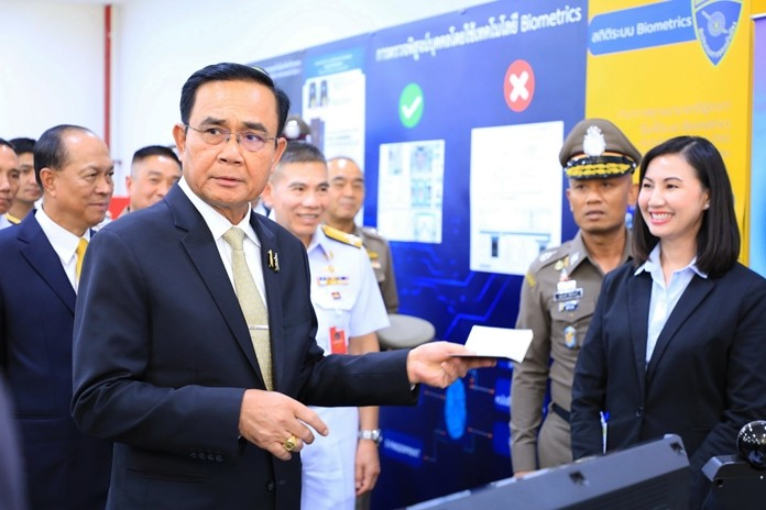 Prime Minister Prayut Chan-o-cha inspects the new passport control area.