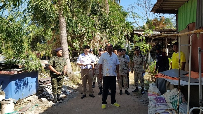Takhiantia sub-district Mayor Manop Prokobthum (center) brought Takhiantia officials to demolish homes cited for encroaching on public forestland the sub-district plans to turn into a park.