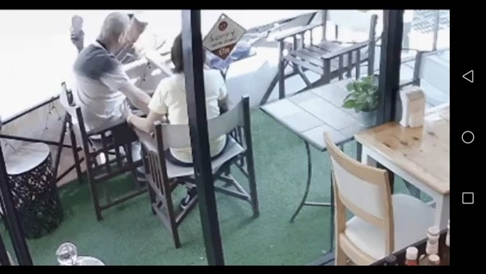 A homeless person hits one of the coffee shop customers.