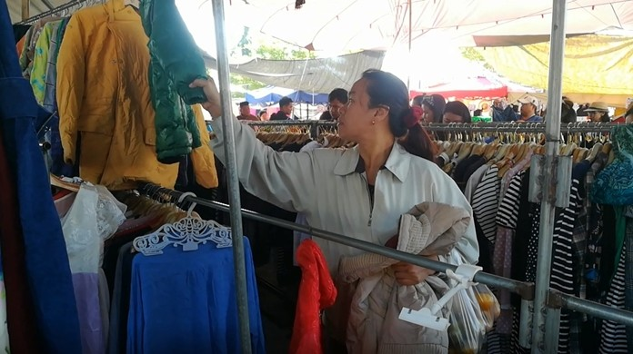 Cold-weather coats are hot sellers this week as Thailand gets its first taste of winter weather. Shopper Uthumporn Kedmeekawe said she can take a day or two of cool air, but 10 days have left her shivering and she needed to stock up on clothing.