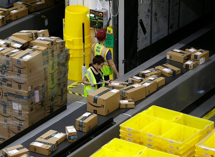 """In this Feb. 9, 2018, file photo packages move down a conveyor system were they are directed to the proper shipping area at the new Amazon Fulfillment Center in Sacramento, Calif. """"Cyber Monday"""" is still holding up as the biggest online shopping day of the year, even though the same deals have been available online for weeks and the name harks back to the days of dial-up modems. (AP Photo/Rich Pedroncelli, File)"""