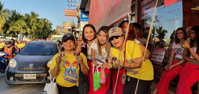 Volunteers hand out free condoms along the parade route.