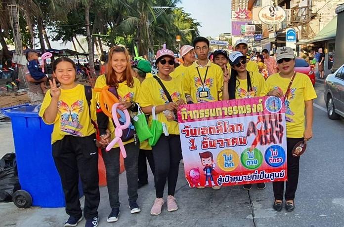 Parade participants promote the AIDS awareness message.