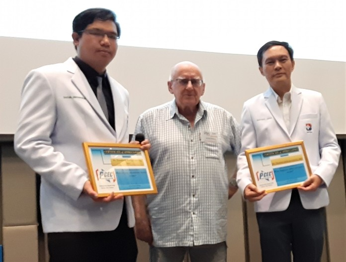 MC Les Edmonds (center) presents Dr. Tanakorn (on his right) and Dr. Natchai (on his left) with the PCEC's Certificate of Appreciation for their enlightening talk about the seriousness of a stroke, its treatment, and rehabilitation.