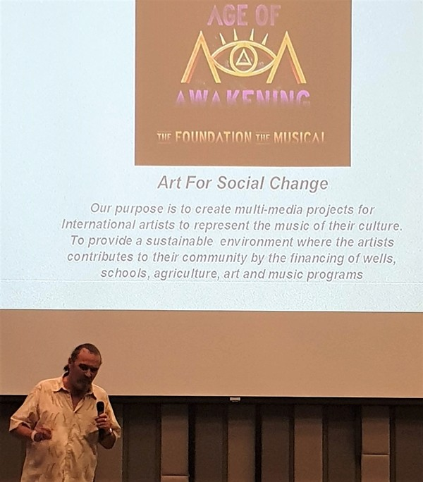 Micheal J. MacIsaac, a man of many creative talents, describes his Age of Awakening Foundation's objective to create multimedia projects containing performances of national and international artists to represent the music of their culture to the outside world.