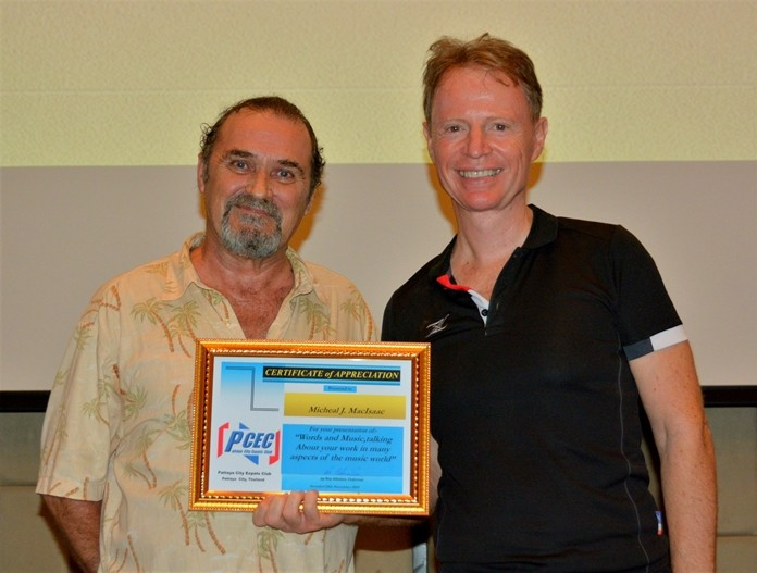 Ren Lexander presents Micheal J. MacIsaac with the PCEC's Certificate of Appreciation for his presentation on his life of creativity and his Age of Awakening Foundation.
