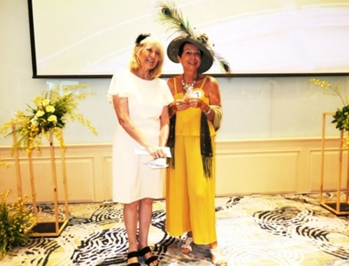 Winner for the most beautiful outfit was Heidi Glemeau, who received her prize from PILC president Sue.