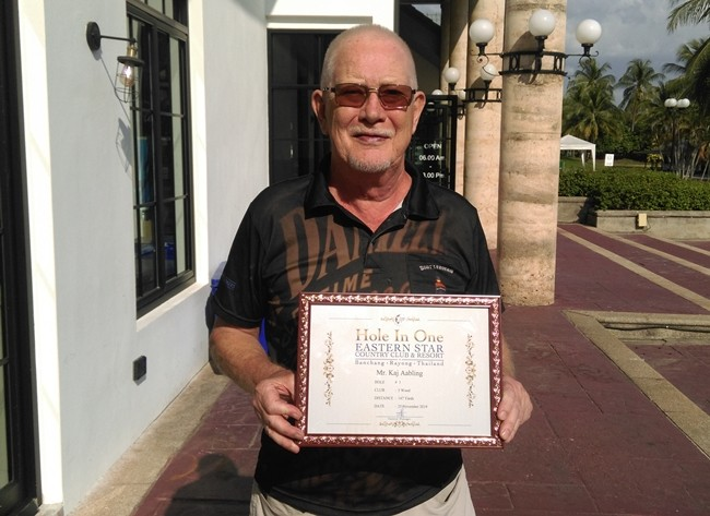 "Kaj Aabling proudly displays his ""Hole In One"" certificate from Eastern Star Country Club and Resort."