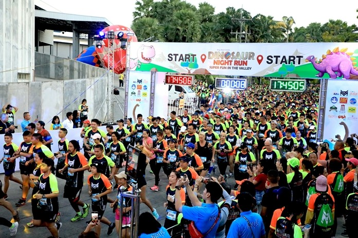 """In a scene straight out of """"Jurassic Park"""", 3,500 people ran for their lives past ferocious-looking dinosaurs at Nong Nooch Tropical Garden's first Dinosaur Night Charity Run."""