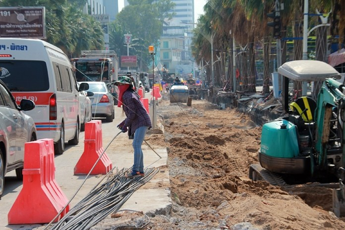 """Pattaya officials say roadwork that has turned Beach Road into a disaster zone during high season will be finished by Feb. 13, well after the current """"high season""""."""
