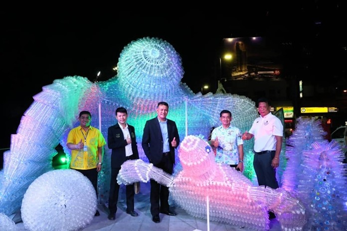 Officials unveil the ironic new landmark, a sculpture of two leatherback turtles made of the very plastic that has helped put them on the endangered-species list.