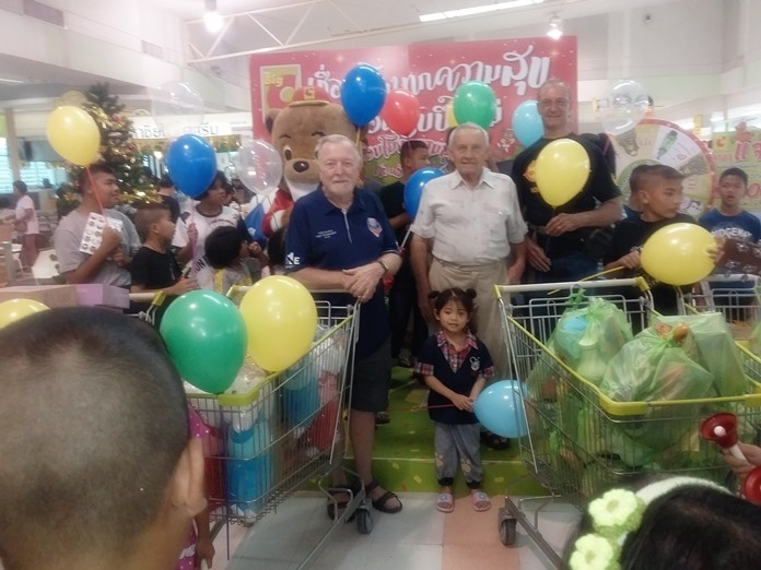 Erle, Bernie and Woody try to help direct shopping cart traffic during the annual Camillian Centre children's Christmas shopping spree.