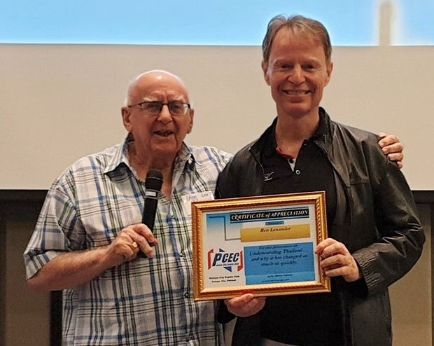 MC Les Edmonds presents Dr. Ren Lexander with the PCEC's Certificate of Appreciation for his insightful and interesting talk about the difference between the beliefs of Thais and Westerners as well as explaining why Thailand has recently changed so much so rapidly.