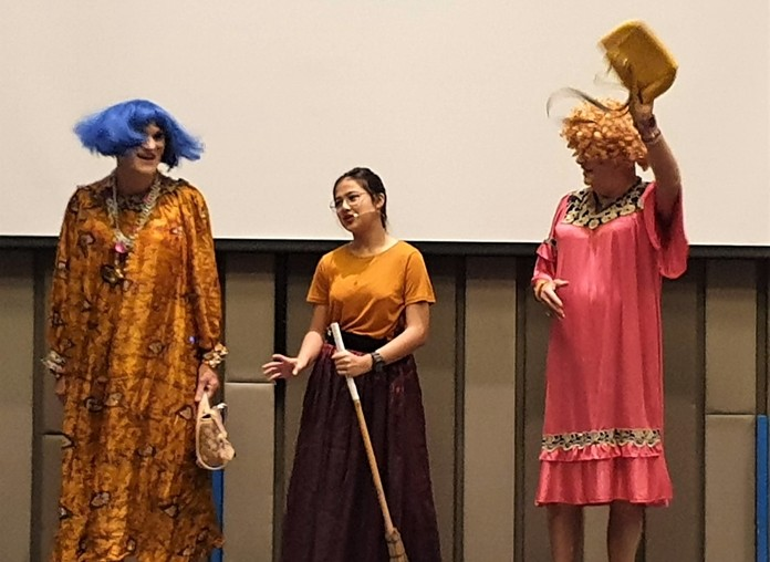 Cinderella, played by Caidie Brennan, appears in this scene with her two very ugly sisters, played by Chris Harman and Doug Campbell.