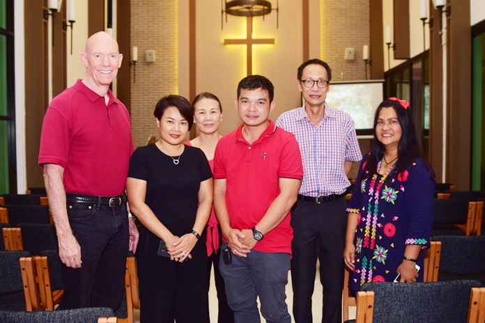 Uboljit Thumchob, Marketing Manager of Rivera Group, Vutikorn Kamolchote, and honored guests celebrate Christmas mass.
