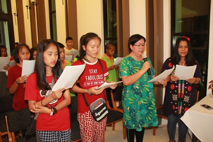 Piangta Chumnoi, Director of Ban Jingjai, brings children under the care of the foundation to a special Christmas mass.