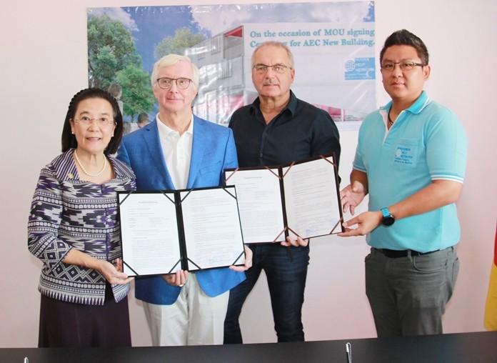 (L to R) Radchada Chomjinda, Hubert Grevenkamp, HHNF German Director Ewald Dietrich, and Siromet Akjrapongpanich pose for a commemorative photo during MOU signing ceremony.