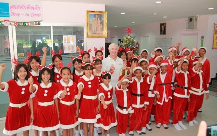 Santa's little helpers dance team takes a break from their performance to say thank you to Hubert Grevenkamp.