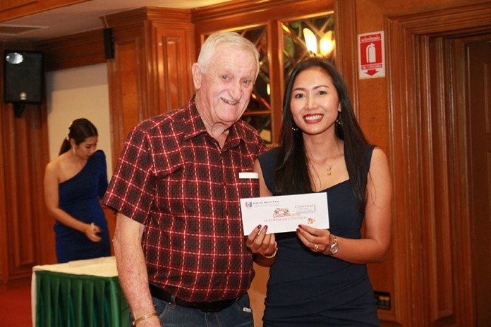 John Player is all smiles as he presents a raffle prize to this charming girl.