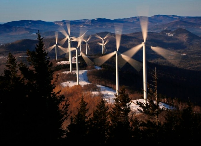 In this March 19, 2019 file photo, the blades of wind turbines catch the breeze at the Saddleback Ridge wind farm in Carthage, Maine. Scientists say emissions worldwide need to start falling sharply from next year if there is to be any hope of achieving the Paris climate accord's goal of capping global warming at 1.5 degrees Celsius (2.7 Fahrenheit). (AP Photo/Robert F. Bukaty, File)