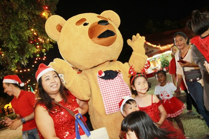 First there was Santa, and then the giant bear made children happy at the party.