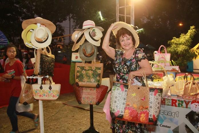 Pattaya Blatt Executive Editor Elfi Seitz tries on one of the hats.