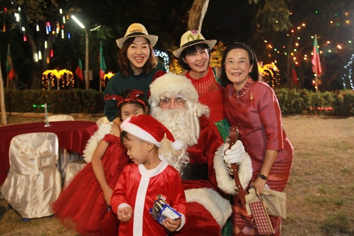 HHNFT Director Radchada Chomjinda (right) brings children and friends to meet Santa.