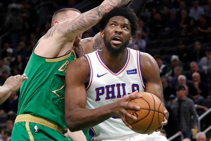 Philadelphia 76ers center Joel Embiid looks for room to shoot against Boston Celtics forward Daniel Theis, left, in the first quarter of an NBA basketball game, Thursday, Dec. 12, 2019, in Boston. (AP Photo/Elise Amendola)