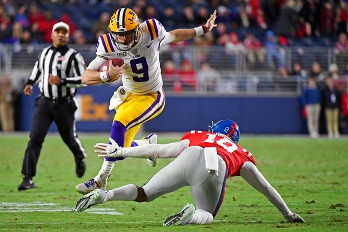 In this Nov. 16, 2019, file photo, LSU quarterback Joe Burrow (9) avoids Mississippi linebacker Jacquez Jones (10) during the first half of an NCAA college football game, in Oxford, Miss. LSU quarterback Joe Burrow is The Associated Press college football player of the year in a landslide vote.  (AP Photo/Thomas Graning, File)