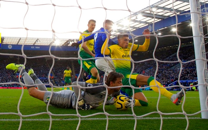 Norwich City goalkeeper Tim Krul makes a save during the match against Leicester City, during their English Premier League soccer match at King Power Stadium in Leicester, England, Saturday Dec. 14, 2019. (Nick Potts/PA via AP)