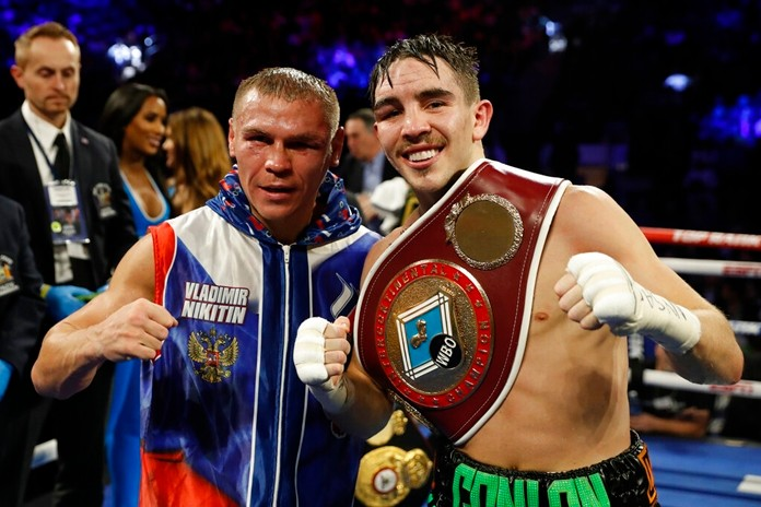 Ireland's Michael Conlan, right, poses with Russia's Vladimir Nikitin after a WBO intercontinental featherweight boxing match, Saturday, Dec. 14, 2019, in New York. Conlan defeated Nikitin by unanimous decision. (AP Photo/Michael Owens)