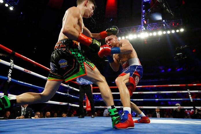 Ireland's Michael Conlan, left, and Russia's Vladimir Nikitin fight during the eighth round of a WBO intercontinental featherweight boxing match, Saturday, Dec. 14, 2019, in New York. (AP Photo/Michael Owens)