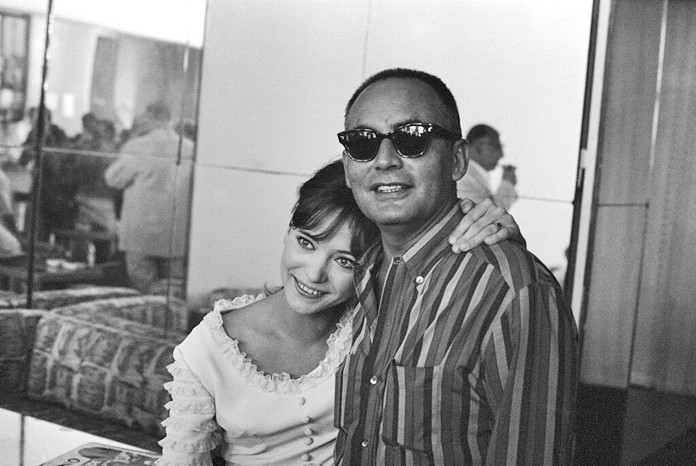 In this Aug.29 1965, file photo, French actress Anna Karina embraces Italian producer Dino De Laurentiis at the end of a press conference on the Venice Lido on the French entry in the International Film Festival. (AP Photo/Mario Torrisi, File)