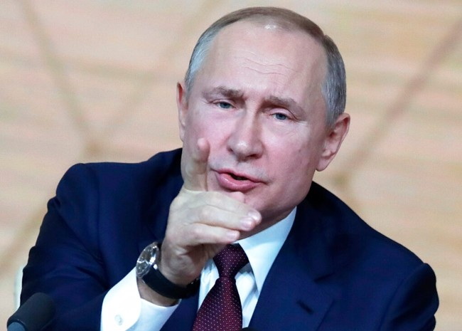 Russian President Vladimir Putin gestures during his annual news conference in Moscow, Russia, Thursday, Dec. 19, 2019. (AP Photo/Pavel Golovkin)