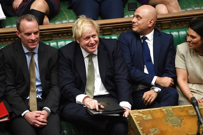 In this photo made available by the UK Parliament, Britain's Prime Minister Boris Johnson, center, attends the debate in the House of Commons, London, Thursday Dec. 19, 2019. (Jessica Taylor/UK Parliament via AP)