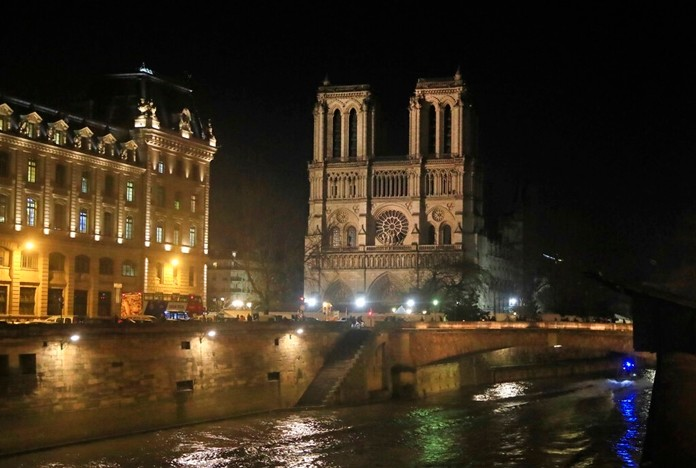 Notre Dame Cathedral is lit up in Paris, Monday, Dec. 16, 2019. The Notre Dame Cathedral has been newly illuminated last month since the April fire in 2019. (AP Photo/Michel Euler)
