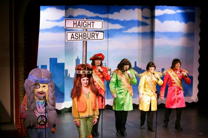 """In this Wednesday, Dec. 4, 2019 photo, characters portraying Haight-Ashbury hippies and the Beatles perform during the musical """"Beach Blanket Babylon"""" in San Francisco.(AP Photo/Eric Risberg)"""