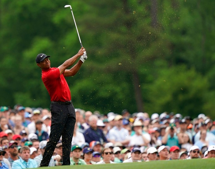 Tiger Woods hits on the 12th hole during the final round for the Masters golf tournament, Sunday, April 14, 2019, in Augusta, Ga. Woods leaned on experience over shots like this to help him win the Masters for the fifth time. (AP Photo/David J. Phillip)