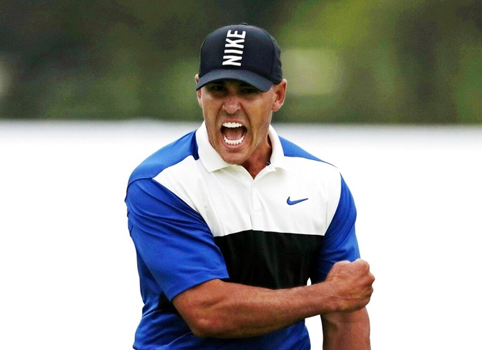 Brooks Koepka reacts after sinking a putt on the 18th green to win the PGA Championship golf tournament, Sunday, May 19, 2019, at Bethpage Black in Farmingdale, N.Y. Koepka says his play out of an awkward lie on the 18th that led to par was one of his most important shots. (AP Photo/Charles Krupa)