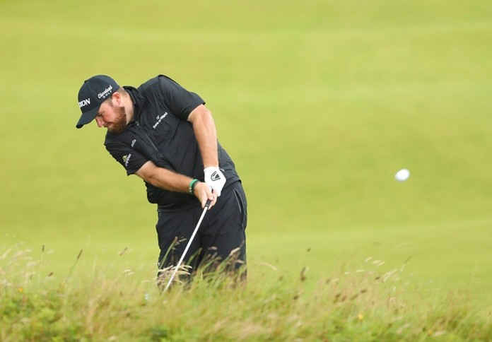 Ireland's Shane Lowry plays a shot from the 8th fairway during the final round of the British Open Golf Championships at Royal Portrush in Northern Ireland, Sunday, July 21, 2019. Lowry says this shot gave him confidence he could handle any shot in the final round. (AP Photo/Peter Morrison)