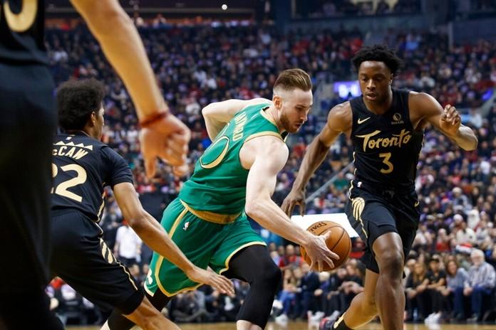 Boston Celtics forward Gordon Hayward (20) drives to the net as Toronto Raptors forward OG Anunoby (3) looks on during first half NBA basketball action in Toronto, Wednesday, Dec. 25, 2019. (Cole Burston/The Canadian Press via AP)